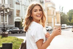 woman smiling with a cup of copy, general dentistry atascocita tx