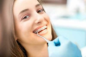 woman being operated on, dental braces tx