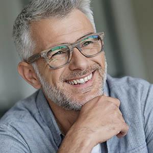 man smiling after dental implants
