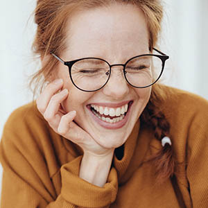 woman smiling after general dentistry