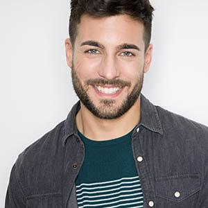 man smiling after dental exam