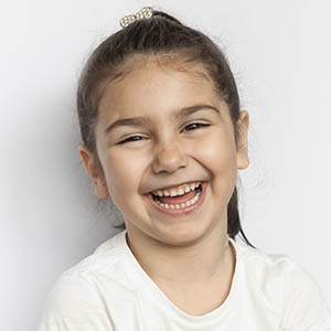 child smiling after pediatric dentistry
