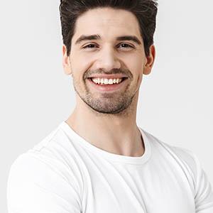 man smiling after teeth whitening