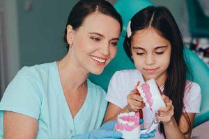 child prepares for pediatric dentistry