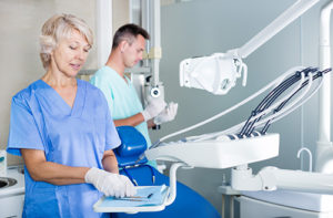 dentists discussing Specialty Dental Services